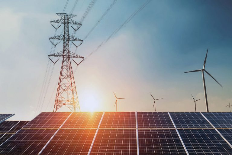 Solar panels with electricity pylon and wind turbine
